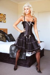 Lace Up Black Corset Bustier With Mini Skirt, White Ribbons, and Spaghetti Straps